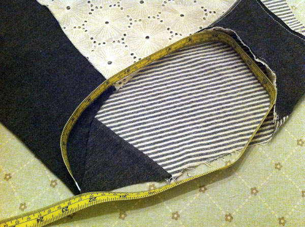 Measuring Tape Overlaying Fabric