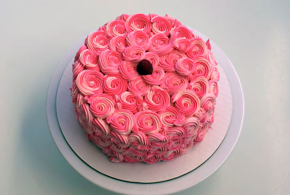 Top of Cake Covered in Pink Rosettes