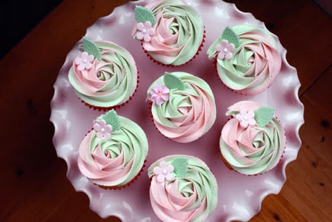 Green and Pink Rosette Iced Cupcakes on Plate