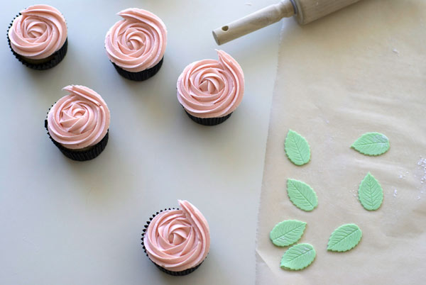 3 Iced Pink Cupcakes, Green Fondant Leaves, Wax Paper