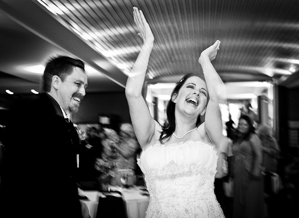 Black and White Image of Bride and Groom on Dance Floor, Bride Clapping