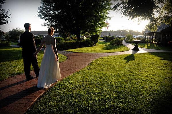 Bride and Groom Walking Down Brick Pathway