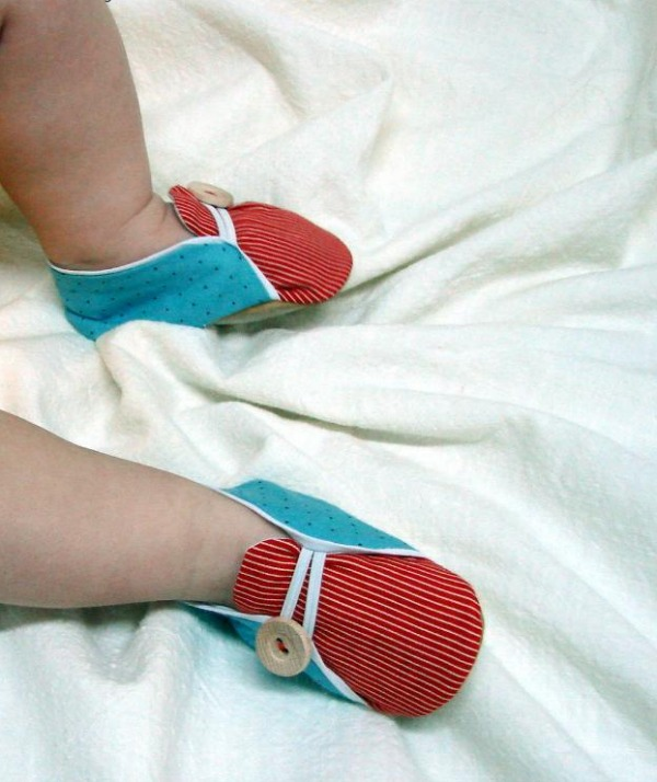Baby Feet Wearing Little Blue and Red Sailor Shoes