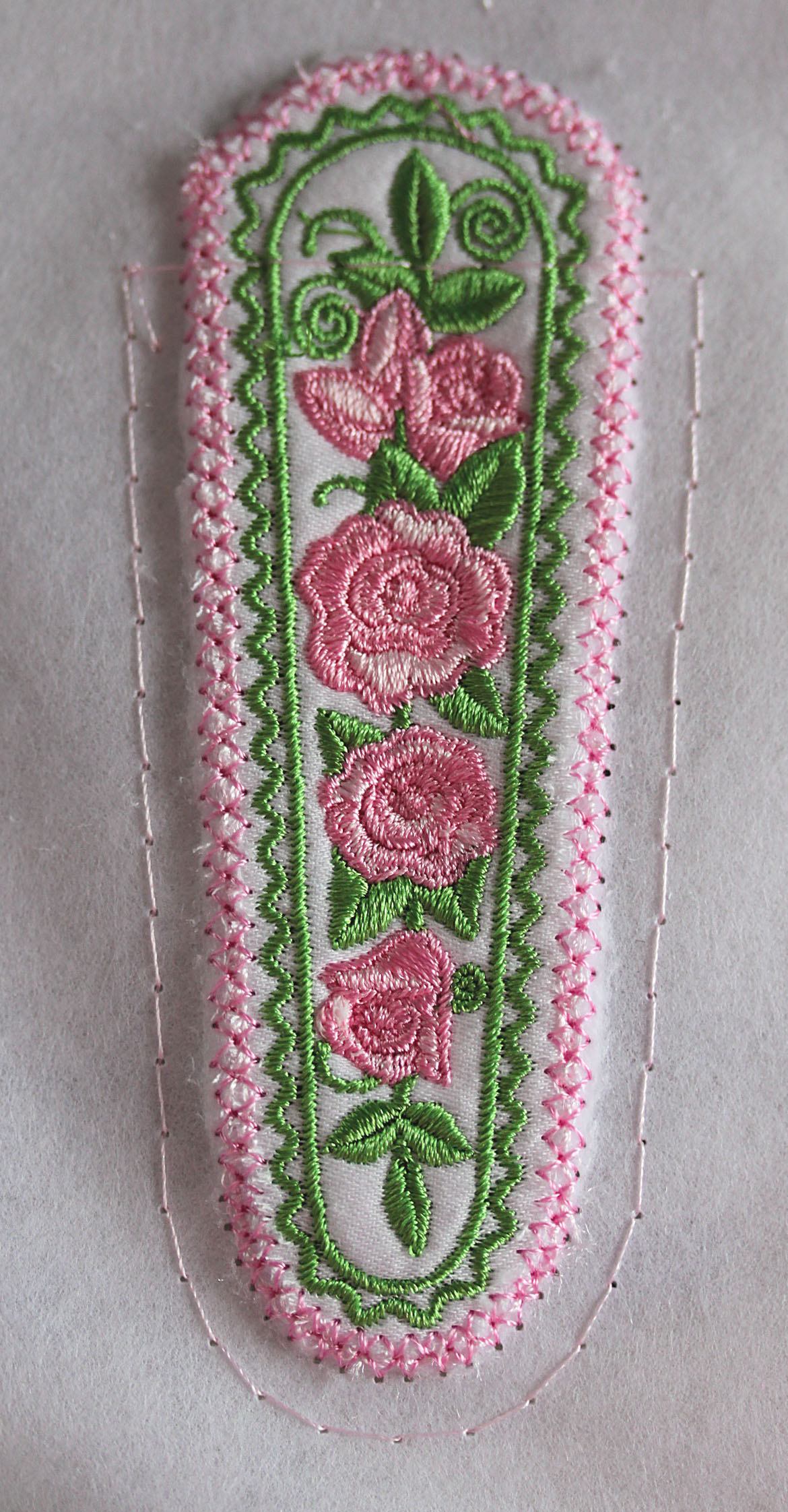 Floral Embroidered Piece Atop Fabric with Outline