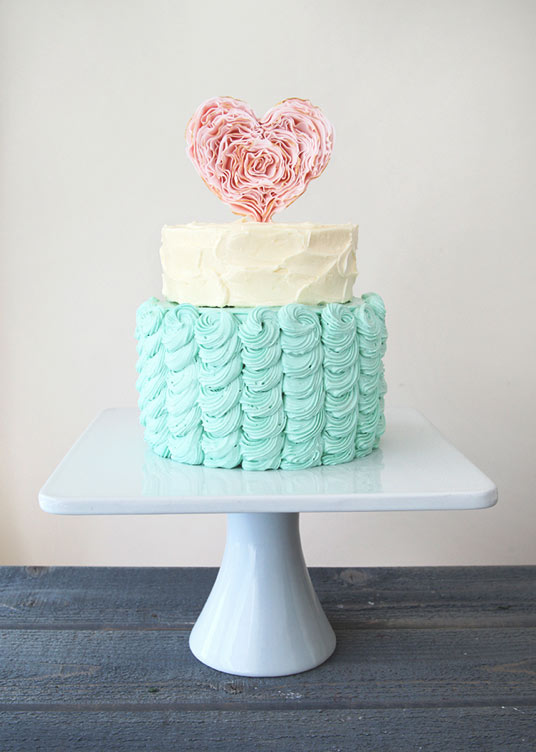 Two-Tiered Pastel Colored Cake with Heart Topper