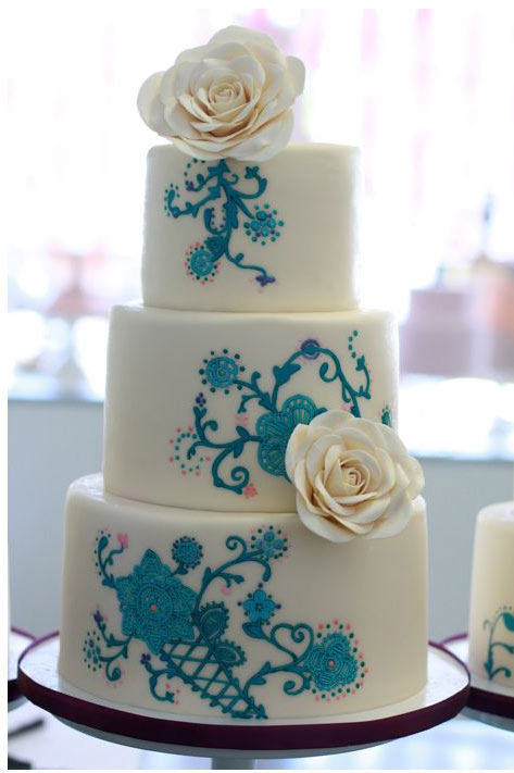 Three-Tiered White Cake with Blue Floral Design and White Roses