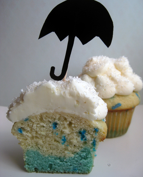 Cupcake Sliced in Half with a Black Umbrella on Top