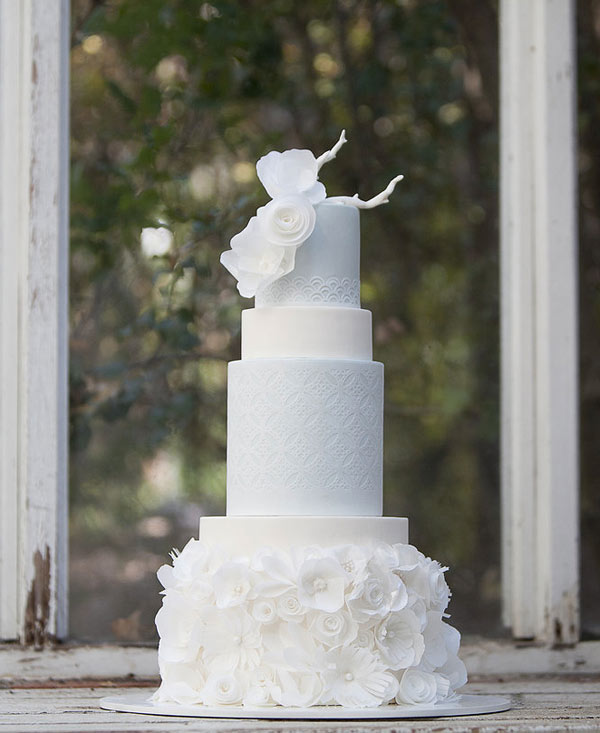 Tiered and Textured White Wedding Cake with Rice Paper Roses