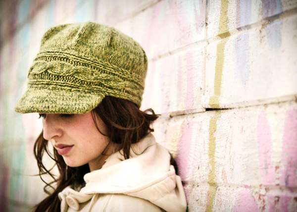 Young Woman Wearing Green Newsboy Hat