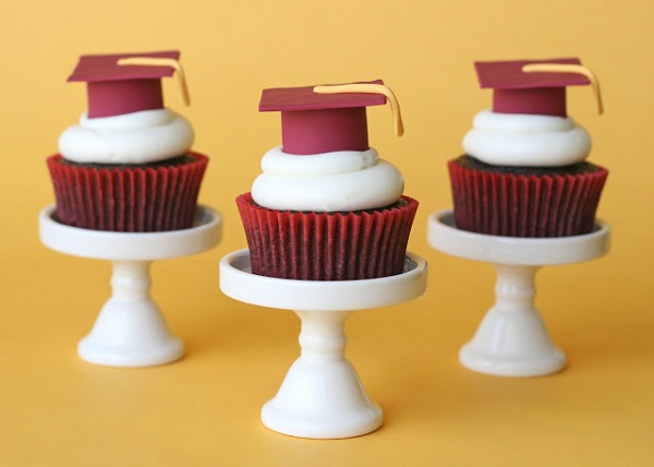 Graduation Hat Fondant Toppers on Three Cupcakes on Stands