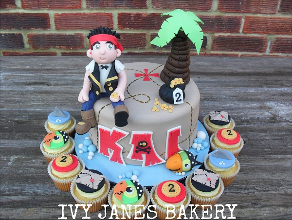 Cake Topped with Pirate Figure and Palm Tree, Cupcakes Topped with Pirate-Themed Fondant