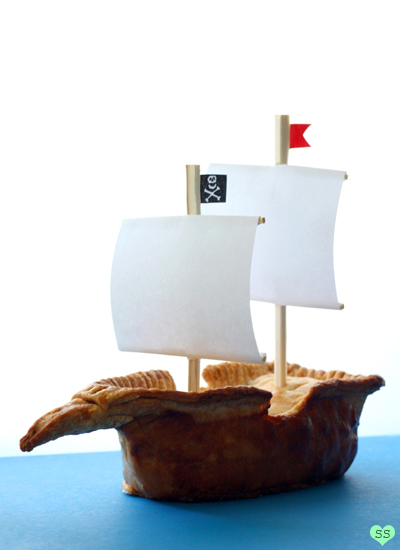 Cake Shaped Like Pirate Ship Sailing on Water
