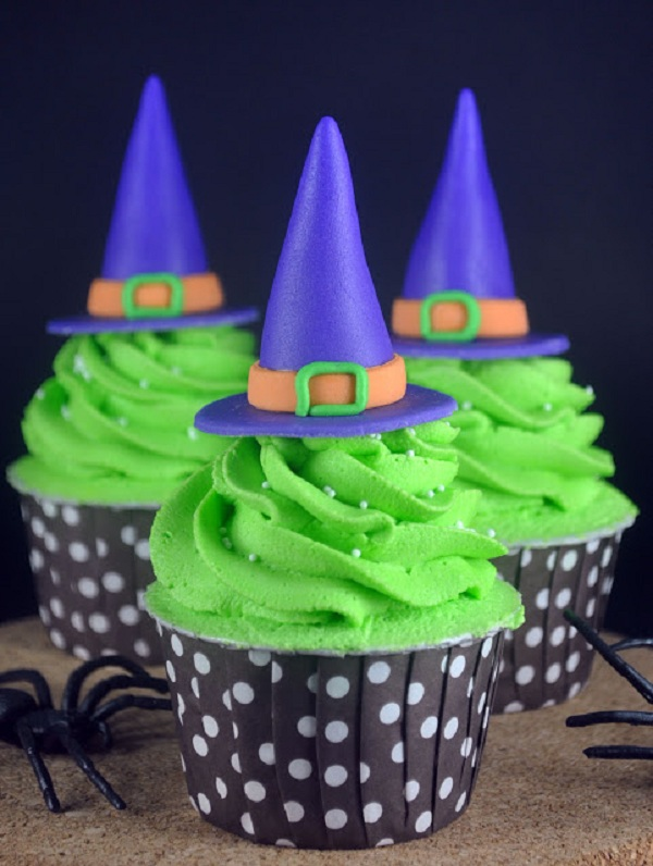 Blue Witch Hats Atop Green Frosting on Cupcakes