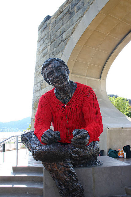 Statue of Smiling Man in a Red Sweater