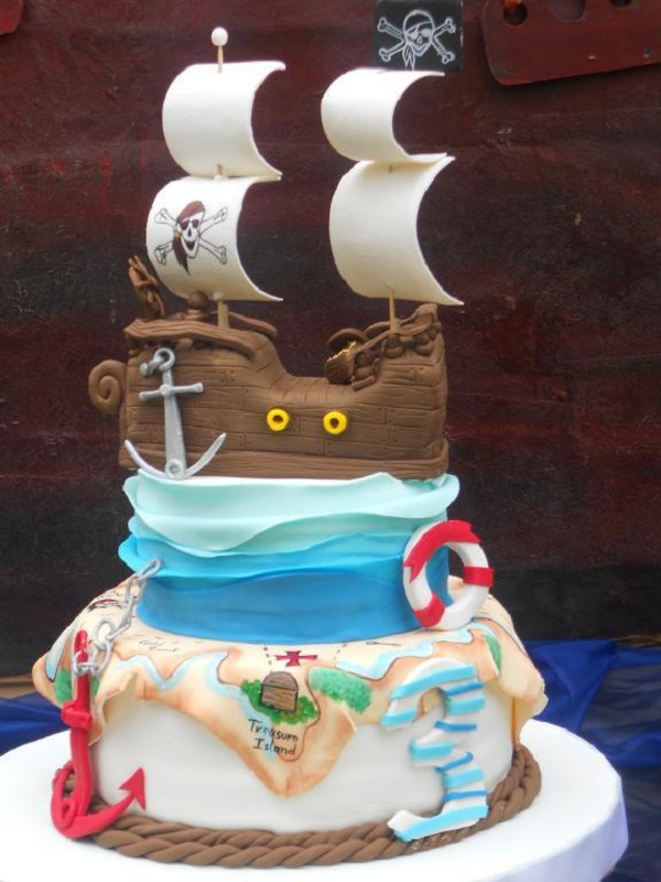 Tiered Cake Featuring Pirate Ship Atop Ruffled Waves