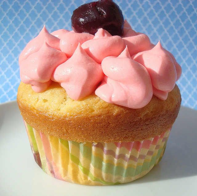 Cupcake Topped with Pink Buttercream and Cherry