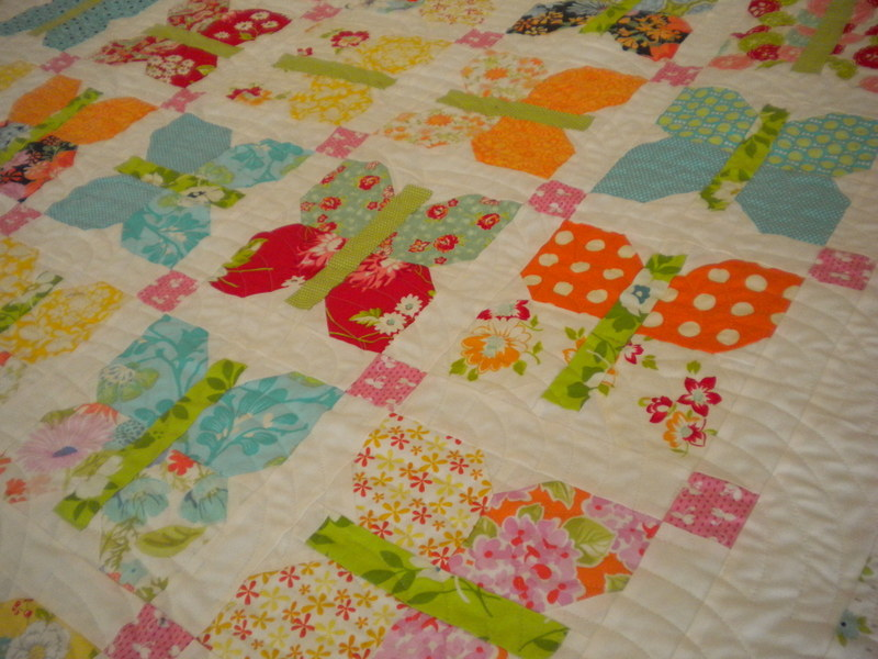 White Quilt with Vibrant Patterned Butterfly Design