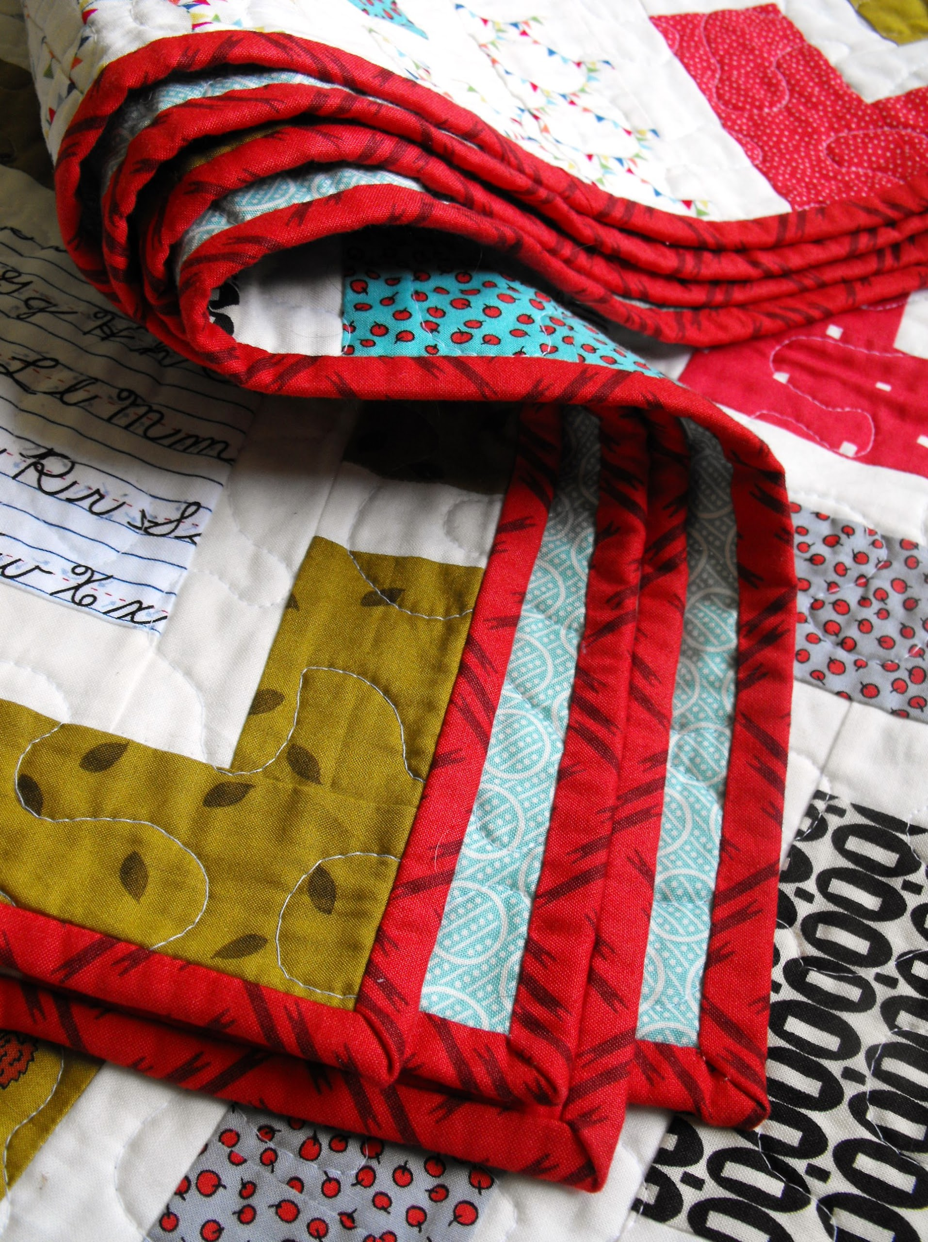 Red Bordered Quilt Folded