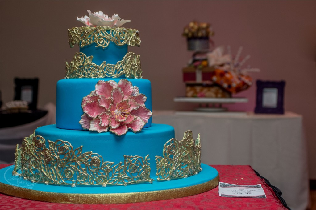 Teal Tiered Wedding Cake with Gold Lace and Large Pink Fondant Flower