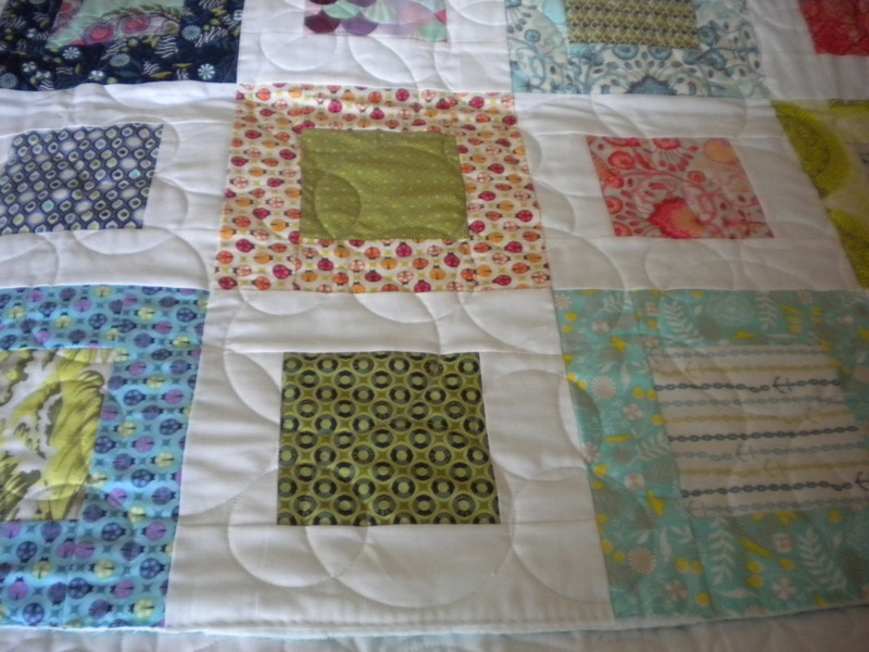 White Quilt with Colorful Patterned Squares and Boxes