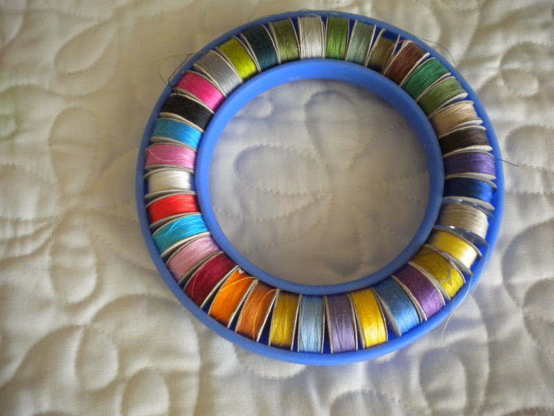 Different Colors of Thread in a Blue Thread Organizer Ring