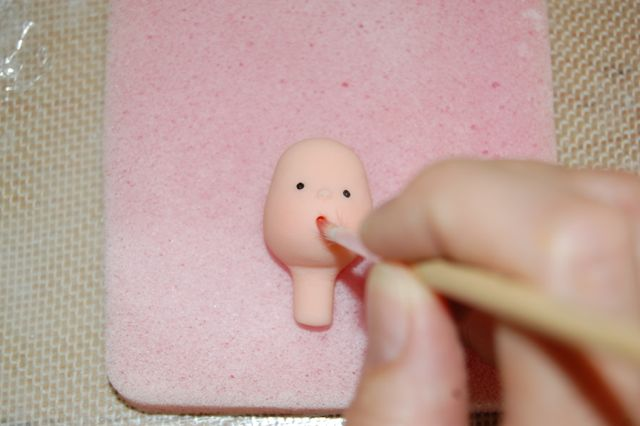 Shaping Fondant Baby Head with Paintbrush