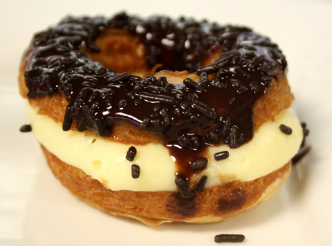 Cronut Filled with Cream, Topped with Chocolate and Sprinkles