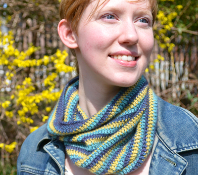 Woman Wearing Striped Scarf, Smiling in Sunshine