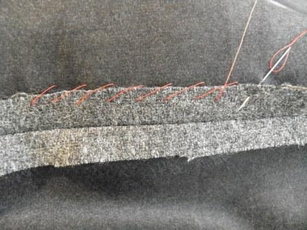 Grey Fabric with Hand Stitches: Overcast Stitch