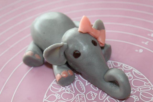 Grey Modeling Chocolate Elephant Laying Down