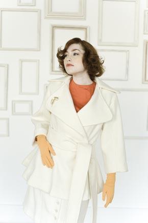 Woman Modeling White Vintage-Style Coat