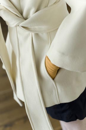 Close Up on Detail of White Vintage-Style Coat