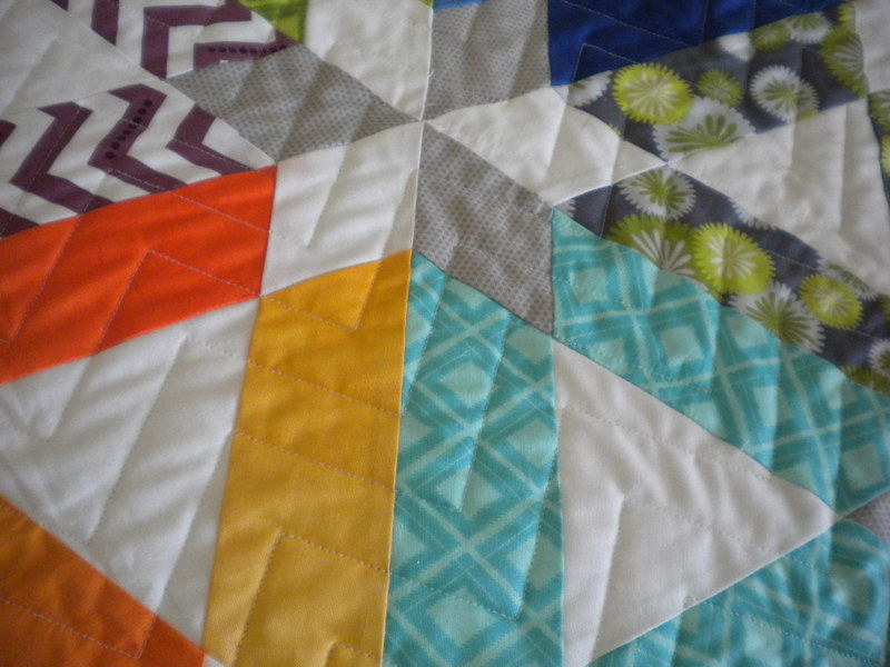 Quilt with Star and Chevron Design