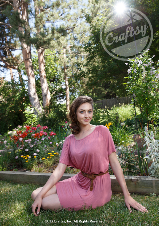 Woman in Pink Dress Sitting in Natural Setting