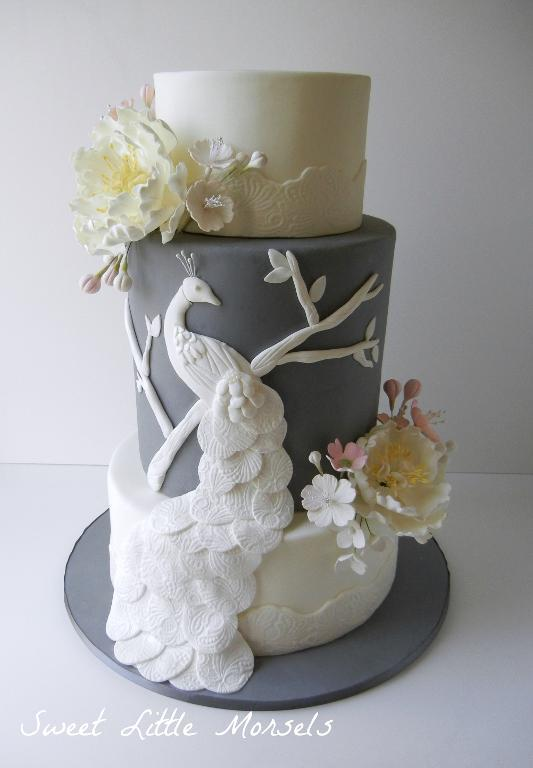 Tiered Cake with White Fondant Peacock Decoration