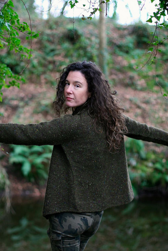 Carol Feller Modeling Brown Sweater