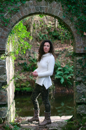 Carol Feller in Stone Archway Modeling White Sweater