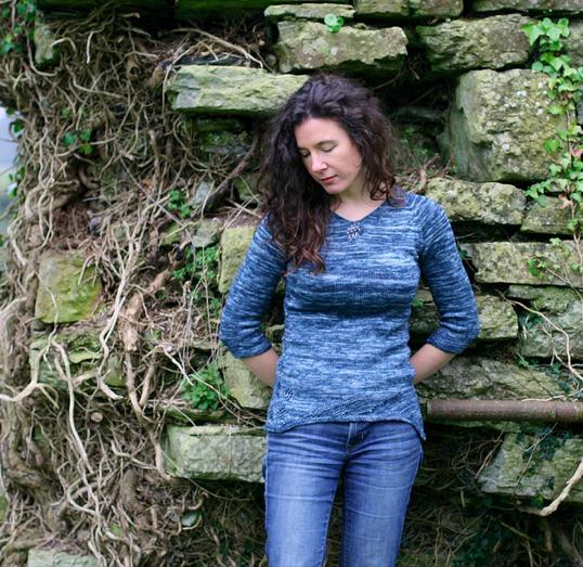 Carol Feller Leaning Against Stones, Modeling Blue Sweater