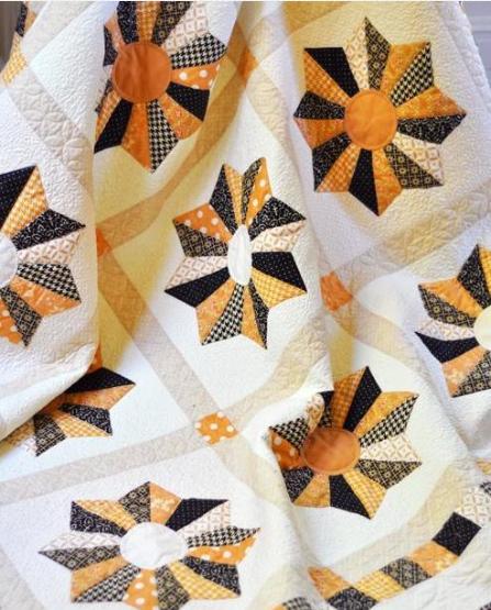 Quilt Featuring Orange and Black Blocks
