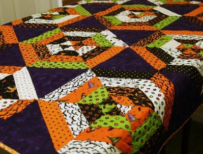Spooky Quilt with Spider Web-esque Pattern in Orange, Green