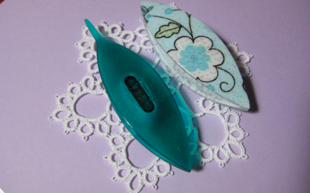 Blue Tatting Shuttle Laying on Lace