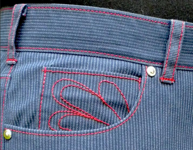 Close Up on Belt Loops of Blue Pants with Red Trim