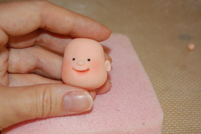 Hand Holding Fondant Baby Head