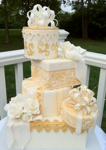 Tiered White and Gold Wedding Cake
