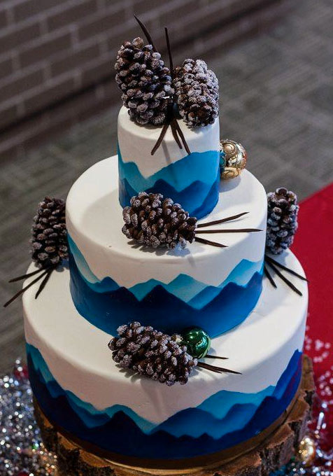 Stacked Winter Cake with Blue Mountains and Pinecone Toppers