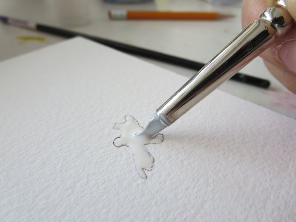 applying masking fluid to watercolor paper with a silicone color shaper