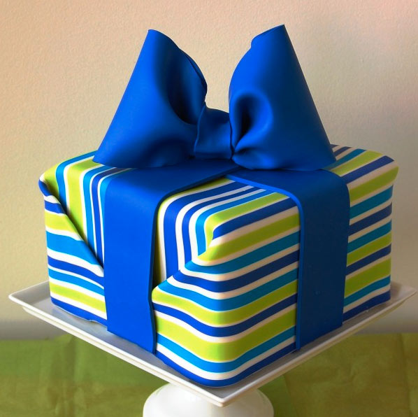 Cake in the Shape of a Striped Gift with Blue Bow