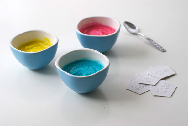Three Bowls with Blue, Yellow and Pink Batter