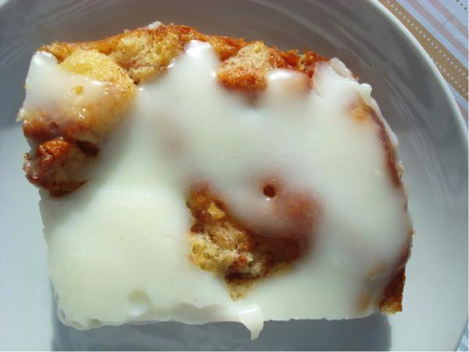 Piece of Bread Pudding on White Plate
