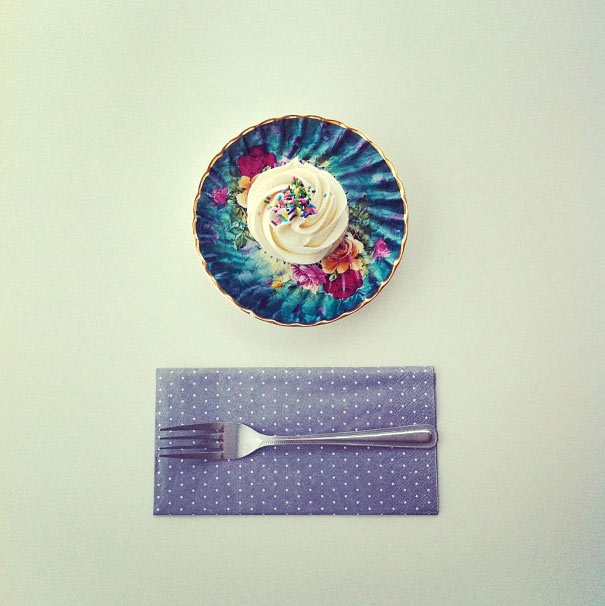 Photo of Top of White Cupcake on Colorful Plate, Napkin and Fork